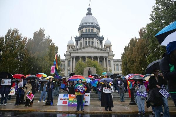 "Supporters of same-sex marriage march Tuesday near the Illinois Capitol. The march's founder said she was ""really disappointed"" in the lack of corporate backing."