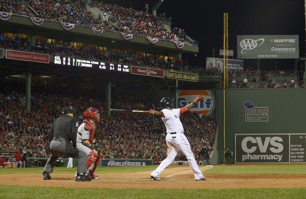 Red Sox DH David Ortiz hits a two-run home run against the Cardinals in the bottom of the seventh inning of Game 1 of the World Series.