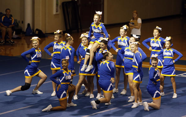 Members of the Aberdeen Central stunting/non-tumbling squad perform at the Aberdeen Central Spirit Invitational at the Golden Eagles Arena this season.