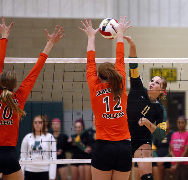 Presentation College's Megan Goedert, right, tries to get the ball past Jamestown College's Sarah Becker (10) and Janna Johnson (12) during Wednesday night's match at the Strode Activity Center.