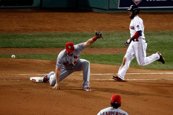 Cardinals first baseman Matt Adams can't make the play as Dustin Pedroia reaches.