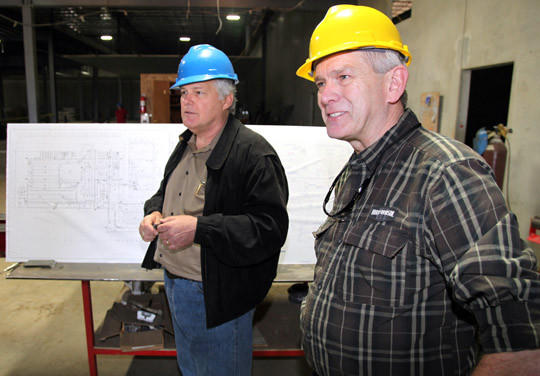 Richard Benda, loan monitor, right, and David Palmer, president and chief executive officer of Northern Beef Packers, center, talk during a tour of the beef plant facility located south of Aberdeen, Friday. photo by john davis taken 6/3/2011
