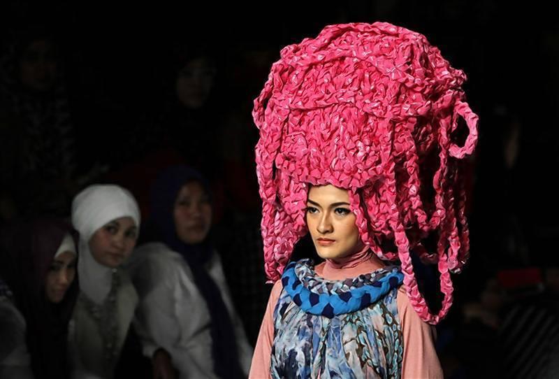 Model presents a creation by Muslim clothing designer Mustafa during a Fashion Week show in Jakarta.