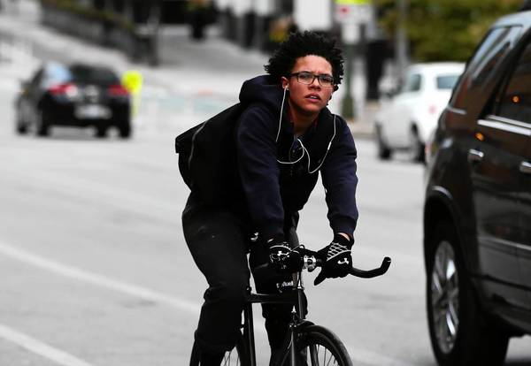 Jessica Smith rides through the intersection of Milwaukee Avenue and Desplaines Street in Chicago on Wednesday. Smith said she was prepared to flout the rule if Chicago aldermen passed a plan for an annual bike registration fee.