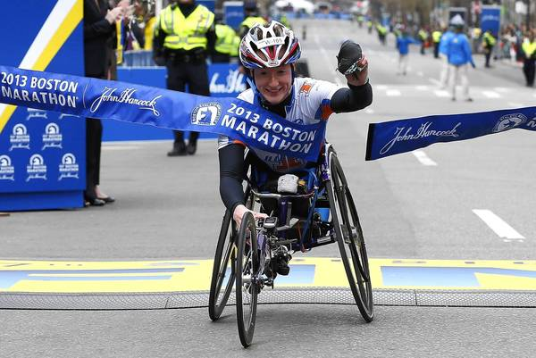 Tatyana McFadden reacts as she crosses the finish line to win the women's wheelchair division of the Boston Marathon.