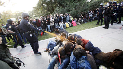 UC pays $38,055 to officer involved in pepper-spray incident