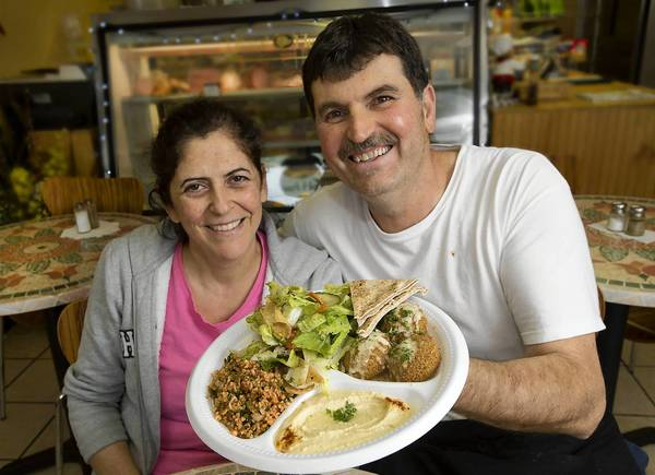 Hellertown Deli and Pita House owners Mounira and Sam Attieh with a falafel salad platter.