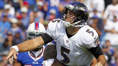 Ravens quarterback Joe Flacco gets hit by Buffalo Bills defensive tackle Alan Branch.