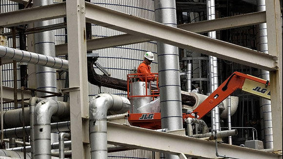 A worker does maintenance at the Citgo refinery in Lemont in a 2002 file photo.