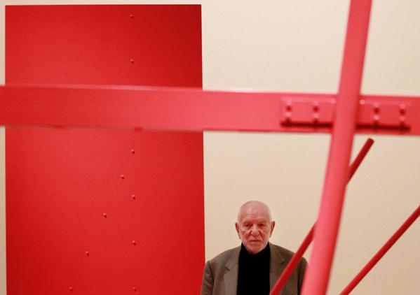 Sculptor Anthony Caro poses with one of his creations at the Royal Academy of Arts in London in 2011.