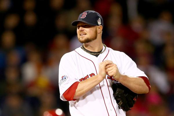 Jon Lester of the Boston Red Sox rubs up a baseball during Game 1 of the 2013 World Series at Fenway Park.