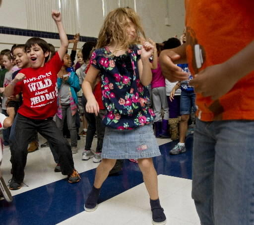 Students dance as Full Spectrum, U.S. Air Force Heritage of America's rock band, performs