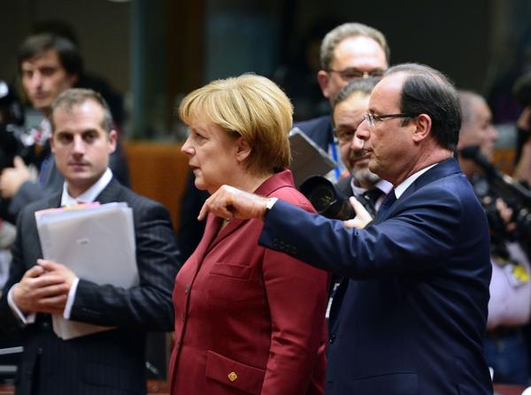 French President Francois Hollande, right, and German Chancellor Angela Merkel, shown arriving Thursday at a meeting of European leaders, both have had telephone conversations with President Obama this week about accusations of massive U.S. spying in their countries and elsewhere.