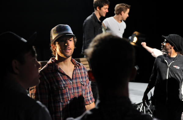 Recording artist Jason Mraz speaks with extras during a video shoot with YouTube stars in Los Angeles.