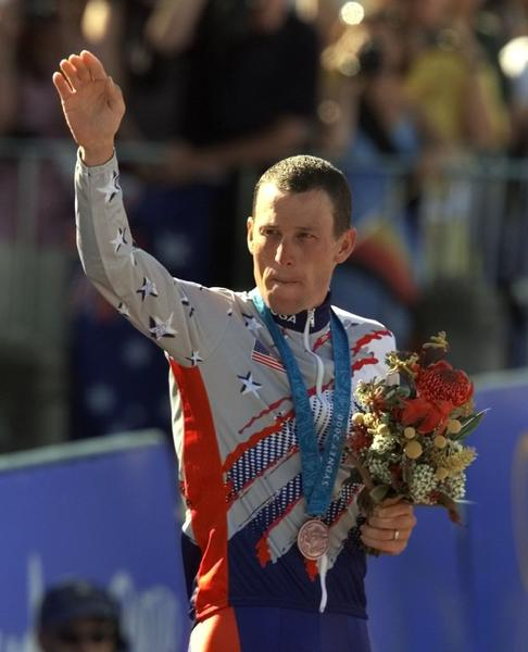 Lance Armstrong waves after receiving the bronze medal in the men's individual time trials at the 2000 Summer Olympics.