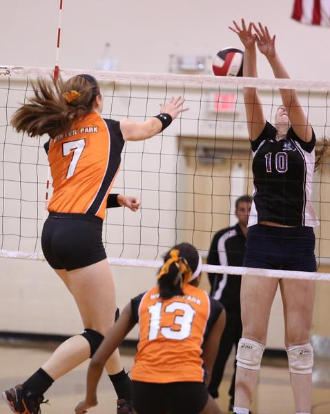 Winter Park's Christina Ambrose (7) hits past Timber Creek's Kristen Johansson (10) during the Timber Creek versus Winter Park High School volleyball game at Colonial High School on Wednesday, October 23, 2013. (Stephen M. Dowell/Orlando Sentinel)
