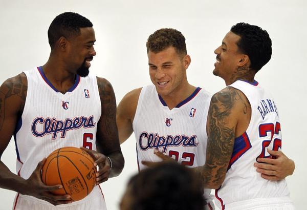 Clippers center DeAndre Jordan, left, forward Blake Griffin, middle, and forward Matt Barnes hug after posing for a portrait during media day Sept. 30.
