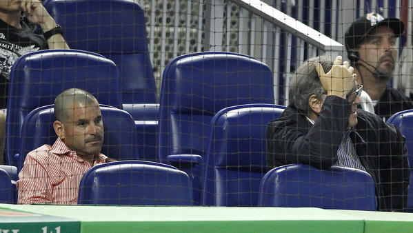 Miami Marlins team president David Samson (left) owner Jeffrey H. Loria (center) his wife Julie (right) during the ninth inning as the Washington Nationals shut out the Marlins 4-0 at Marlins Park in July 2012. photo/Robert Mayer