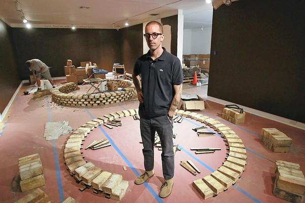 "Adam Silverman stands where one of his installations will be as part of the ""Clay and Space"" exhibit at the Laguna Art Museum."