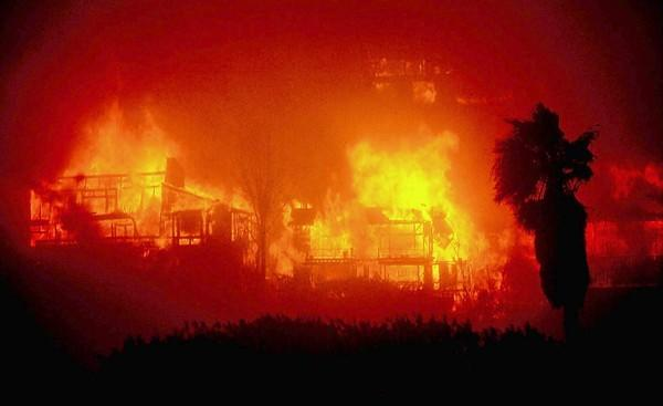 Two homes burn out of control after being pre-heated by Santa Ana winds on Londonderry Road in Emerald Bay on Oct. 27, 1993.