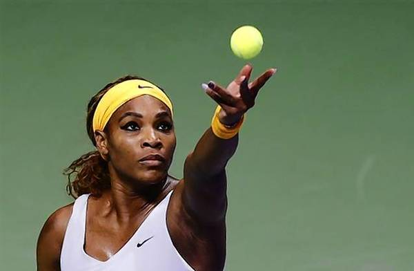 Serena Williams of the U.S. serves during her WTA tennis championships match against Petra Kvitova of Czech Republic at Sinan Erdem Dome in Istanbul October 2013.