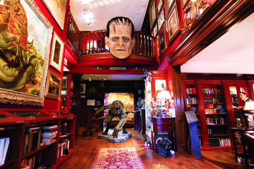 The foyer of Bleak House is a treasure trove of film memorabilia, books and artwork. The enormous head of Boris Karloff as Frankenstein's monster can be seen, made by former Tussauds sculptor, Mike Hill. A life-size sculpture of H.P. Lovecraft can be seen in the Horror Library to the right.
