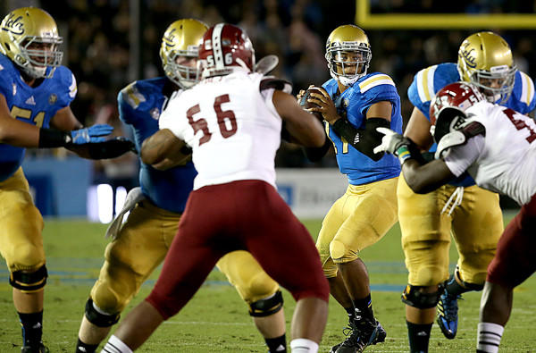 The UCLA offensive line gives quarterback Brett Hundley plenty of time in the pocket against the New Mexico State pass rush in the first quarter of a game earlier this season.