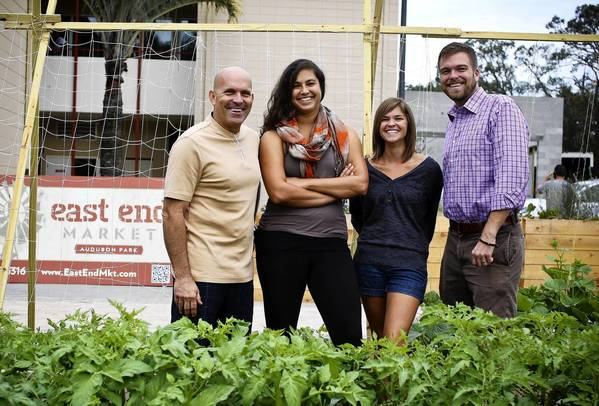 East End Market opens Friday in Orlando. Pictured: contractor Ron Scarpa; market director Gabby Lothrop; community manager Heather Grove; and developer John Rife.