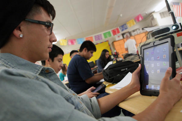 Students at Theodore Roosevelt High School receive iPads as part of LAUSD's Common Core Technology Project.