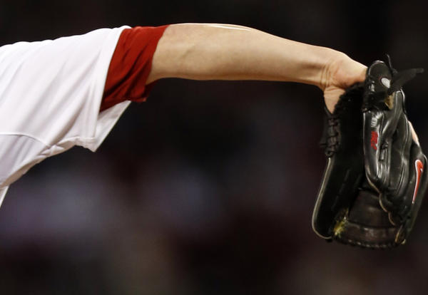 Detail of glove of Boston Red Sox starting pitcher Jon Lester (31) as he throws against the St. Louis Cardinals during game one of the 2013 MLB baseball World Series at Fenway Park.