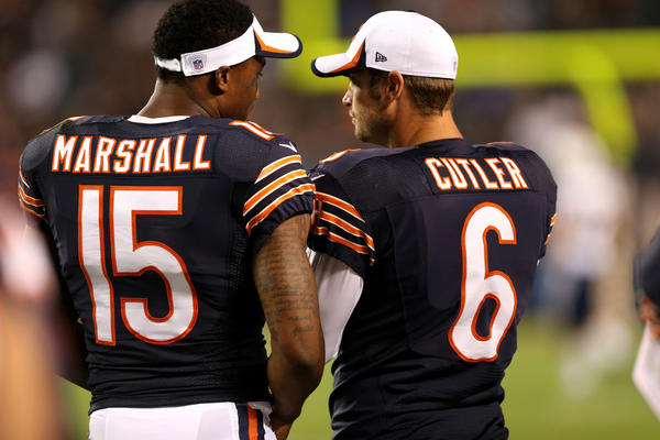 Bears wide receiver Brandon Marshall and quarterback Jay Cutler stand beside one another on the sideline during a preseason game at Soldier Field.