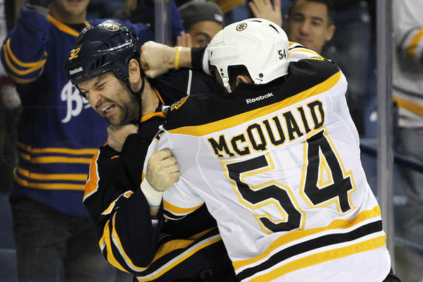 Sabres defenseman John Scott and Bruins defenseman Adam McQuaid fight during the third period at First Niagara Center.