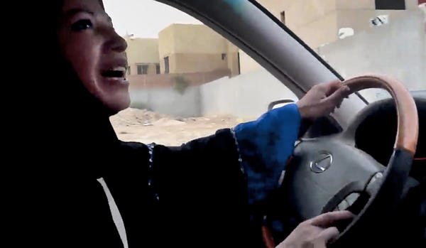 "In this file image made from video released by Change.org, a Saudi Arabian woman drives a car as part of a campaign to defy Saudi Arabia's ban on women driving, in Riyadh, Saudi Arabia. A relative handful of brave Saudi women will slip behind the wheel on Saturday for a ""Day of Female Driving."""