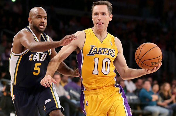 Lakers point guard Steve Nash drives past Jazz point guard John Lucas III during a preseason game at Staples Center.