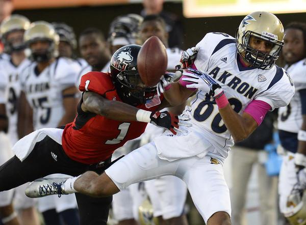 Northern Illinois safety Dechane Durante breaks up a pass against Akron wide receiver Jerrod Dillard.