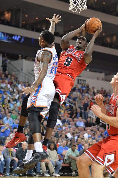 Luol Deng(drives to the basket against Oklahoma City's Rodney McGruder during the first half at Intrust Bank Arena.