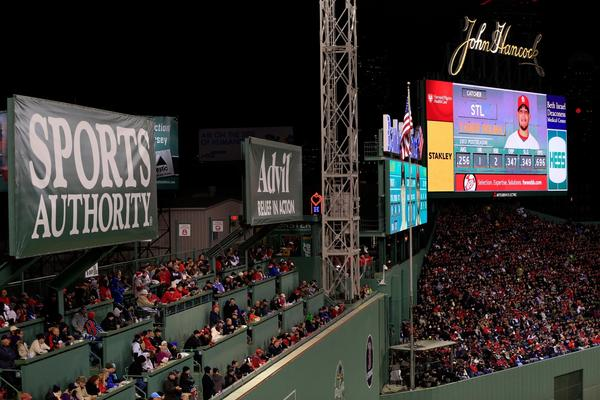 Fans watch from the Green Monster during Game 2.