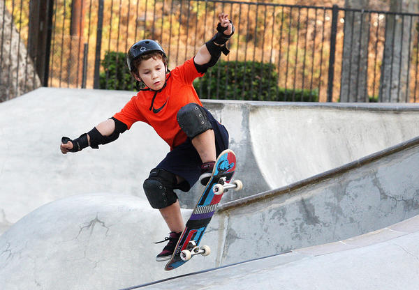 Nathaniel Frink, 11, of La Crescenta, catches air on his board at the Verdugo Skate Park in Glendale on Wednesday, Oct. 23, 2013. The park attendance has dropped in the past year after fees increased 50 percent last October.