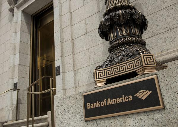 Bank of America says it's cutting 1,200 employees in its mortgage division. Above, a bank branch near the White House in Washington.