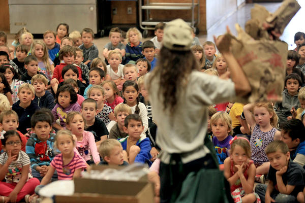 Woodland Elementary School kindergarteners look on as Dr. Francene Kaplan shows examples of brown waste during a composting presentation on Thursday.