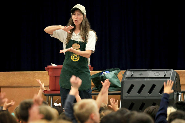 "Francene Kaplan explains to group of kindergarteners how composting will help benefit their school's ""Kinder Garden"" during a presentation at Woodland Elementary School in Costa Mesa on Thursday. At right, one of three compost bins the Costa Mesa Sanitary District is offering for purchase. For more information Costa Mesa residents can visit cmsdca.gov."