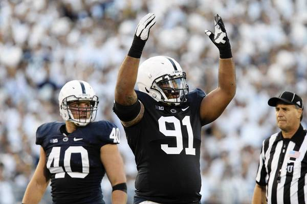 Oct 12, 2013; University Park, PA, USA; Penn State Nittany Lions defensive tackle DaQuan Jones (91) during the second quarter against the Michigan Wolverines at Beaver Stadium.