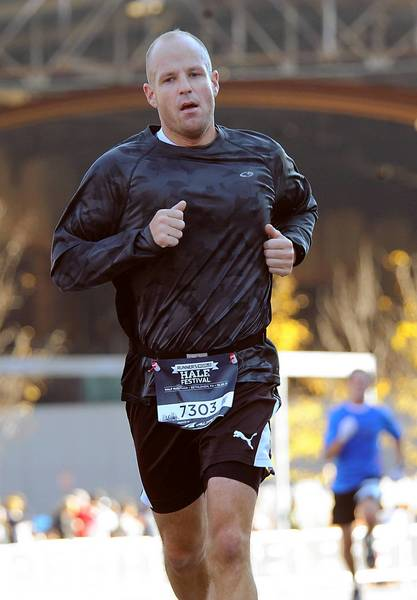 Adam Reitz of Bethlehem heads to the finish line at Bethlehem's SteelStacks, during the Runner's World Half-Marathon in South Bethlehem on Sunday, October 20, 2013.
