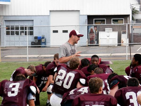 Lehighton head coach Tom McCarroll addressing his team after practice.