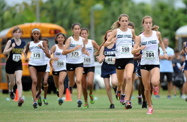 Julia Montgomery (#164) of Pine Crest finished first and teammate Katherine Jovanovic (#159) finished second at the District 15-2A Cross Country meet at Mills Pond Park, Fort Lauderdale, FL. 10/24/13. Jim Rassol, Sun Sentinel...