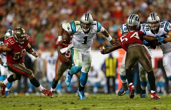 Panthers QB Cam Newton rushes during a game against the Buccaneers at Raymond James Stadium.