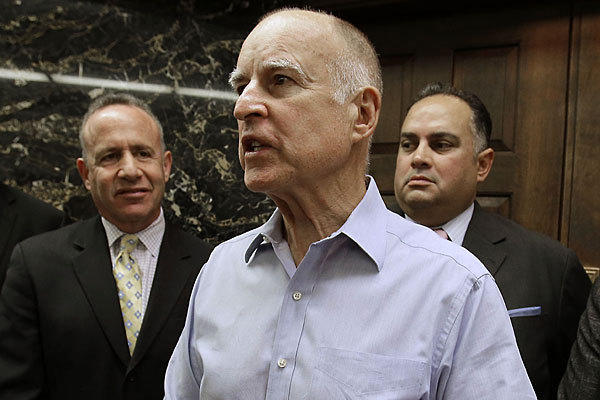 From left, California Senate leader Darrell Steinberg (D-Sacramento), Gov. Jerry Brown and Assembly Speaker John Perez (D-Los Angeles) at a news conference on prisons in September.