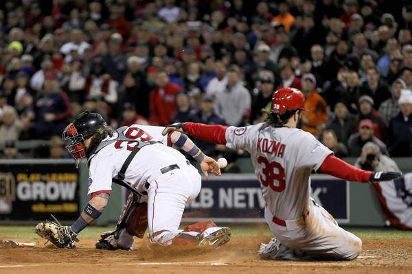 Pete Kozma of the Cardinals scores in the seventh inning during St. Louis' win over the Red Sox during Game 2 of the 2013 World Series at Fenway Park.