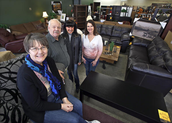 Deb and J.R. Wood, co-owners of J.R.'s Furniture with sales associates Barb Moser, center and Lisa Sumption, right, in the businesses showroom.