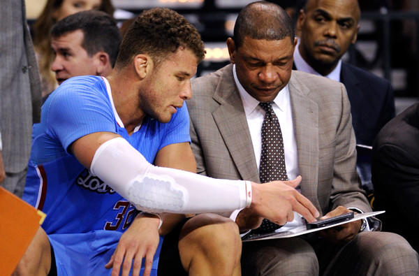 One can only presume that forward Blake Griffin is discussing strategy and not who should get playing time with Coach Doc Rivers.